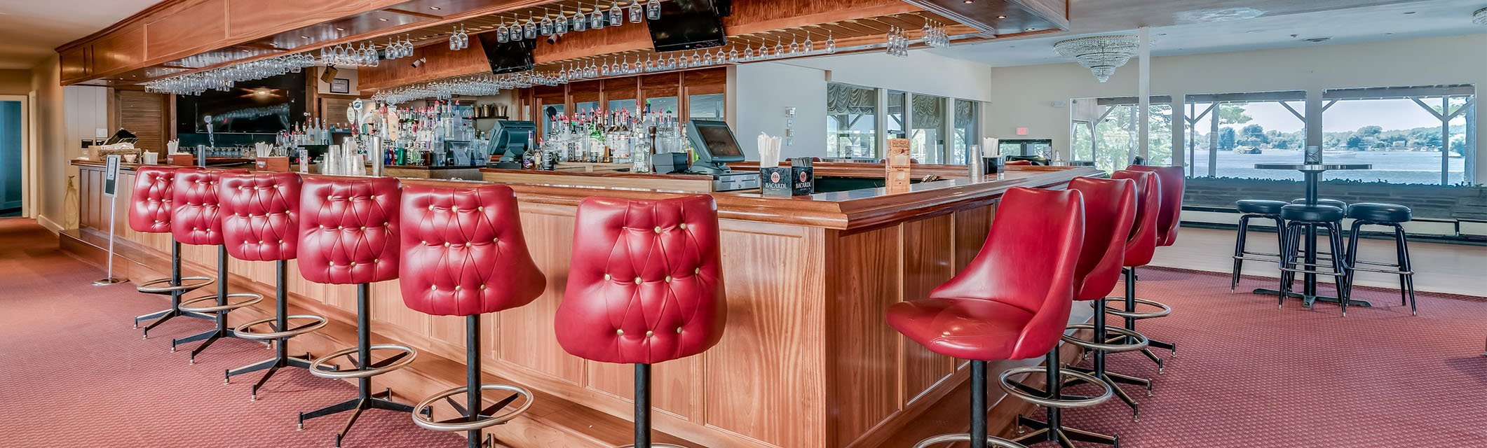 red bar stools around a bar
